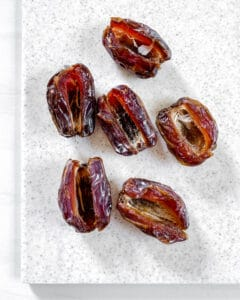 stuffed dates process showing all 6 dates post being cut in half partially