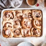 apple pie cinnamon rolls in tray with several ingredients in the background