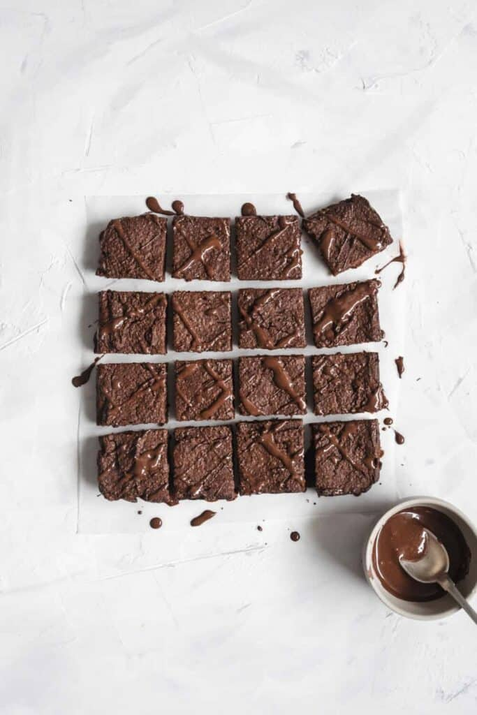 finished pumpkin chocolate brownies cut into pieces against a white background